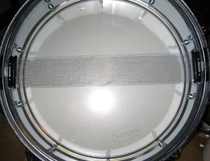 The wires of a snare drum