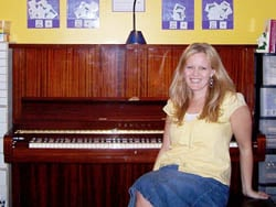 Natalie at her new piano