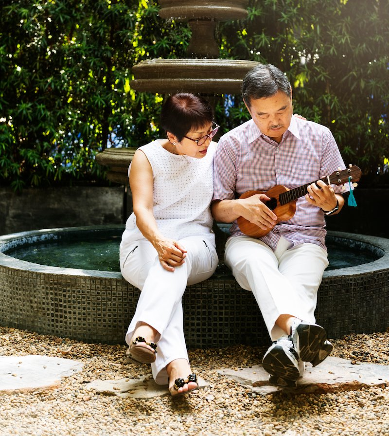 Senior Couple Fountain Ukelele Instrument Concept