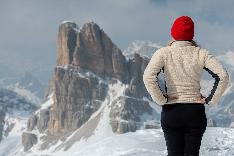 woman contemplating dolomites panorama landscape