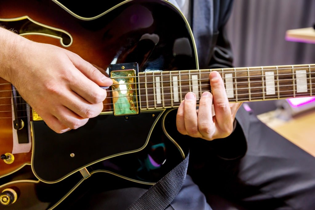 Arpegiatted guitar chord being played