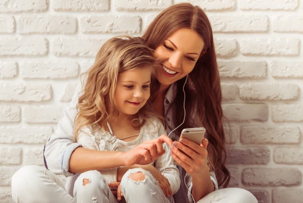 Mother and daughter enjoying music together